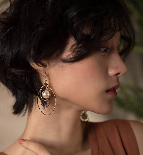旋轉珍珠垂墜式耳環